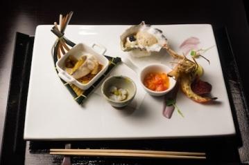 Zensai: Loup de Mer, Baby Potato, Fanny Bay Oyster Caviar, Australian Blue Shrimp, Yuzu Tomatoes, Japanese Octopus, and Wasabi Flower